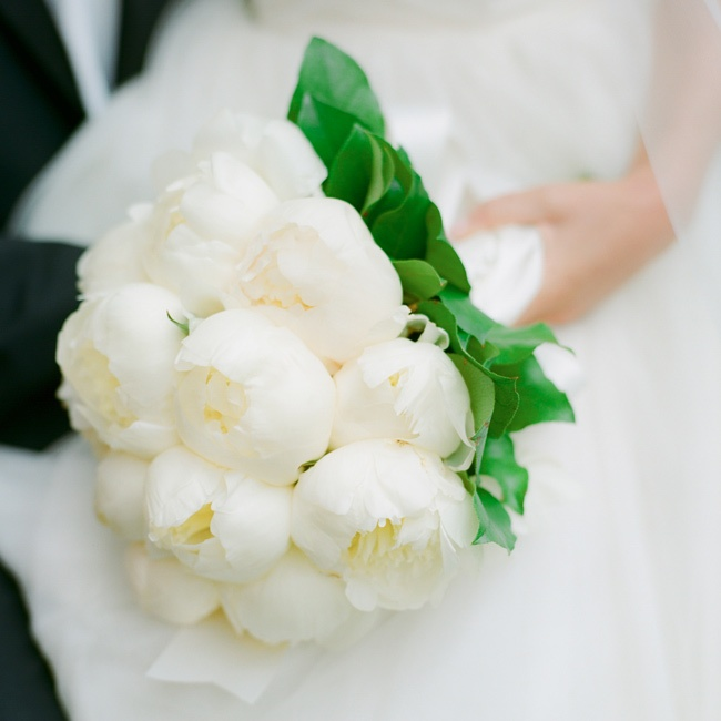 Freddy loved how her bouquet of fluffy white peonies looked with the layer of tulle in her dress.
