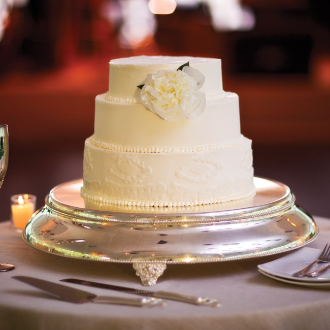 The elegant three-tiered pound cake was adorned with a single fresh flower.
