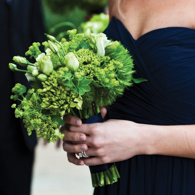 Liz's maids carried organic green bunches of baby hydrangeas, lisianthus, lady's mantle and trick dianthus.
