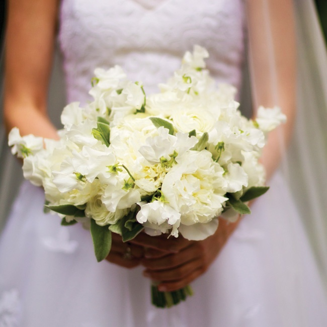 Hints of green made Liz's earthy arrangement of white roses and carnations pop against her gown.