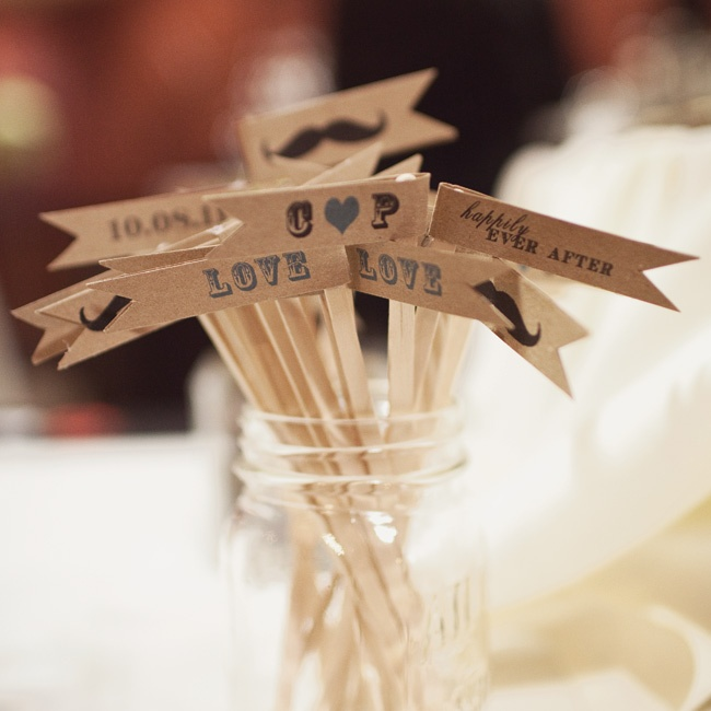Guests could find these playful custom drink stirrers by the bar.