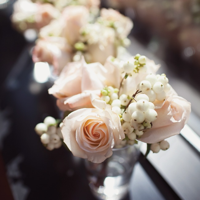 The mothers and grandmothers of the bride and groom carried these delicate bunches of pale-pink roses and white hypericum berries.