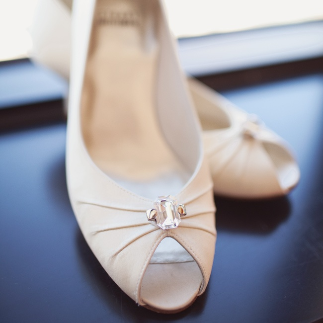 Courtney's ivory peep-toe pumps got a subtle touch of glam from a single gem.