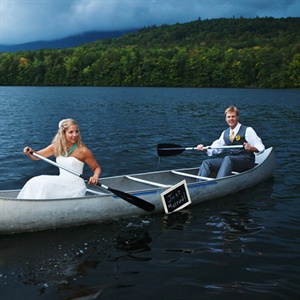 "After the ceremony, Laura and Mark took a ""just married"" canoe ride around Bradley Lake."