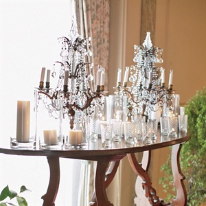 The couple placed candelabras, votives and pillar candles at the entrance to the reception to produce a romantic vibe.