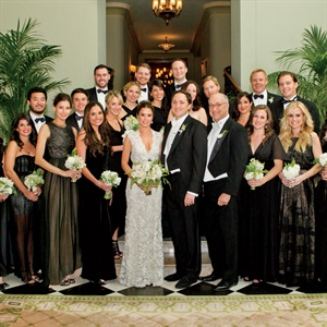 Annie's bridesmaids wore various long black gowns and the groomsmen wore formalwear from Brooks Brothers.