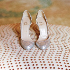 The bride picked out a gorgeous pair of Louboutins to go with her Monique Lhuillier gown.