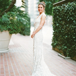 "The lace beaded V-neck Monique Lhuillier gown ""was the perfect dress!"" says Anne. To match her classic style, Scott donned a formal black tuxedo with tailcoat."