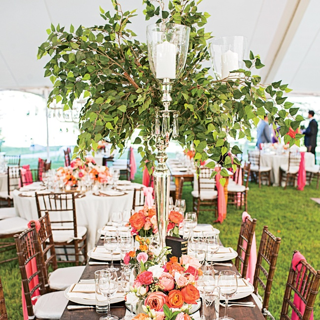 Going along with their rustic-elegance theme, the couple used a mix of long wooden farm tables and classic rounds.