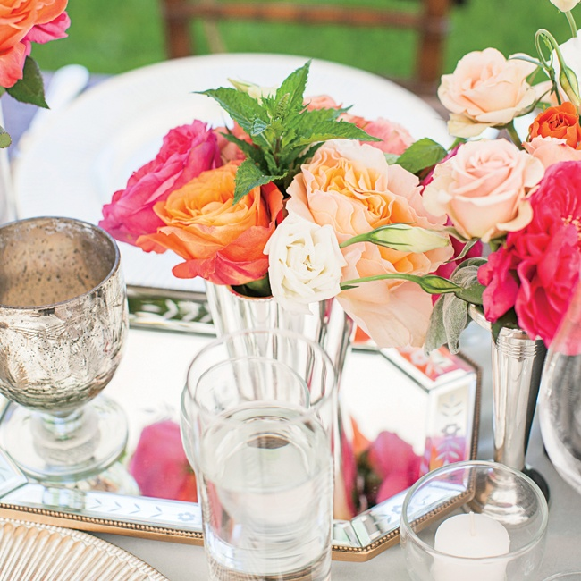 Vibrant coral, pink and white roses topped sage velvet