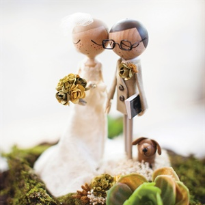 The cake topper was a replica of the couple in their wedding attire, with their dog next to them.