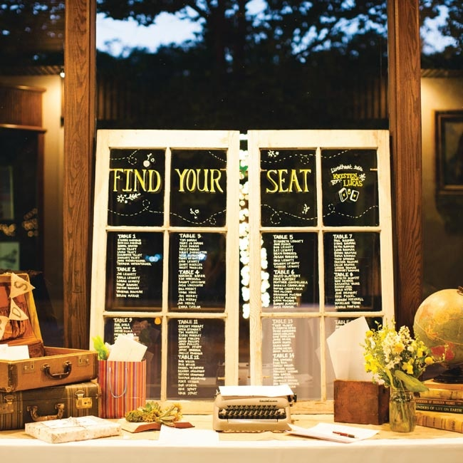 Instead of paper escort cards, the couple chose a more eco-friendly approach: A drawn-on window told everyone where to sit.