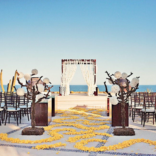 A unique swirled petal design covered the aisle and led to a flower-draped wooden huppah made by local artists.