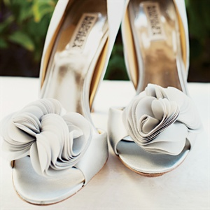 In line with the couples color palette, Meka wore pale-gray