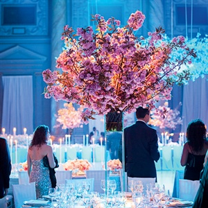 The tall cherry blossom centerpieces added to the enchanting, fairy-tale inspired decor.