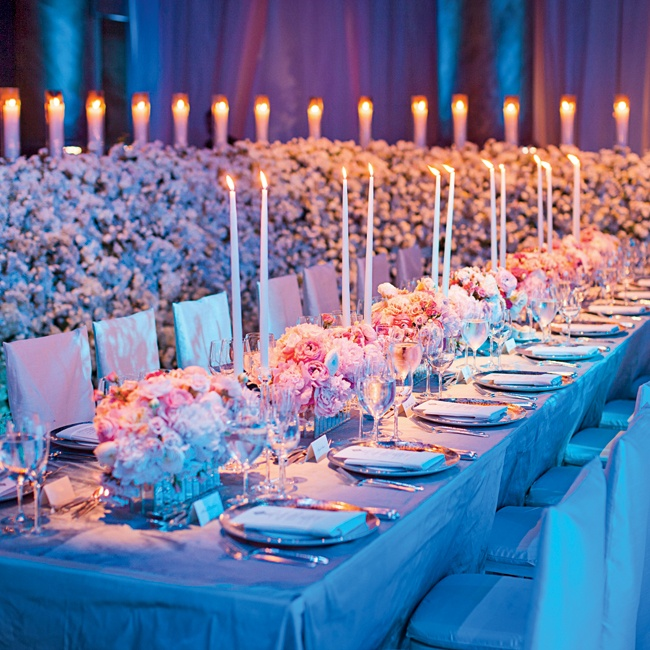Long reception tables were covered with a light gray cloth and finished with tall candles and rose and peony centerpieces to work in their pink, white, silver and gray palette.