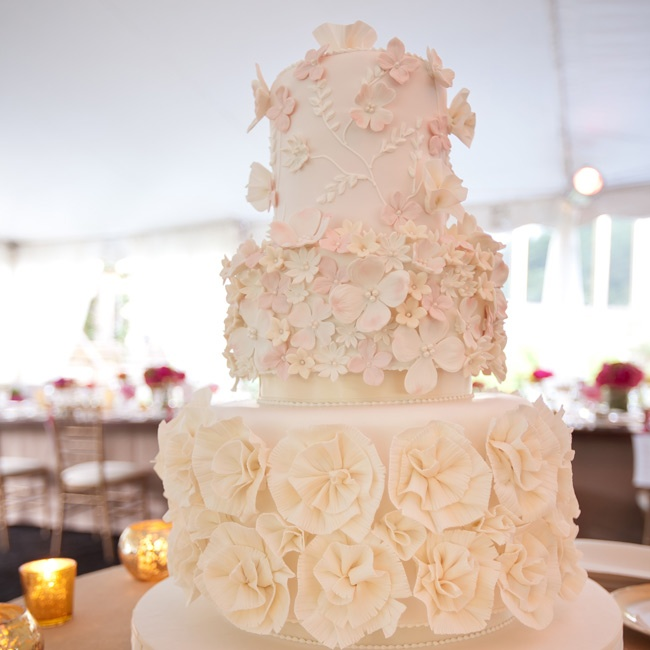 The sugar flowers on the couple's cake were made to look like the bottom of Thandi's wedding dress.