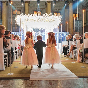 Two adorable flower girls escorted the ring bearer down the aisle and stole the audiences attention.