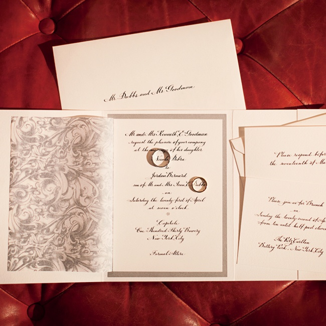 The couple's formal invitations fit well with the enchanted urban theme.