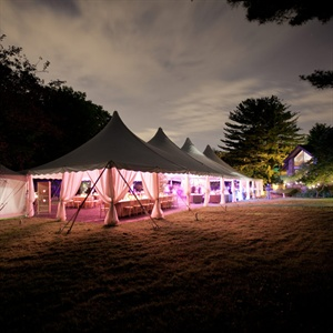 The reception tent was accented with chandeliers and colored lighting.