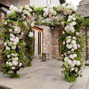 The couple exchanged vows beneath this hydrangea-and-rose-decorated huppah.