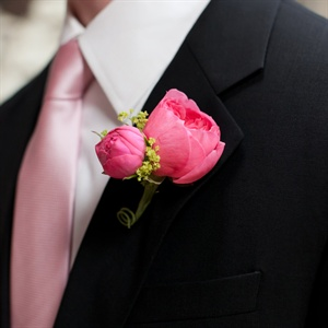 The groomsmen wore fuchsia peonies on their lapels to match their ties.