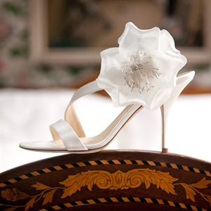 Thandi wore these strappy heels with a floral detail that matched her dress.