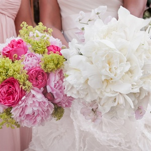 The bridesmaids held vibrant bunches of pink peonies and garden roses, while Thandi carried an all-white ruffled bouquet of orchids, peonies and garden roses.