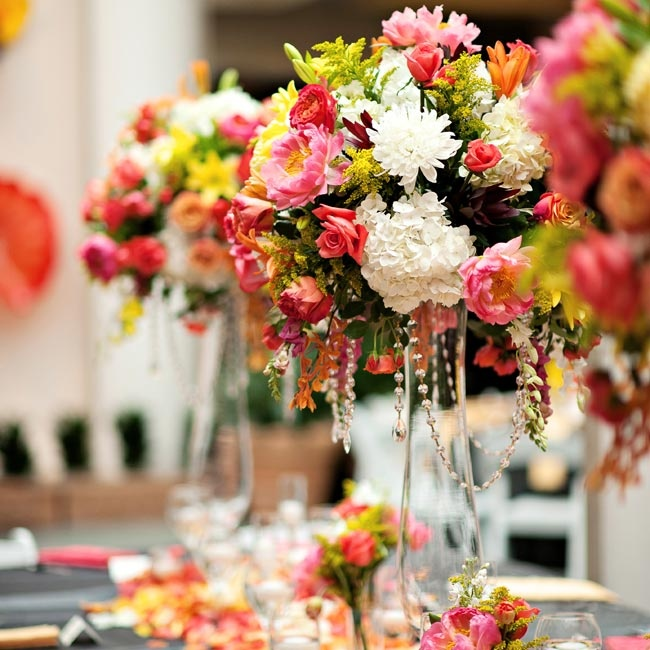Tall arrangements of pink, coral, yellow and white hydrangeas, roses, peonies, tulips and Asiatic lilies decorated the head table.