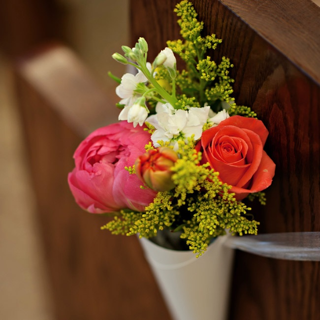 Peonies, snapdragons, tulips and roses adorned the ends of alternating pews.