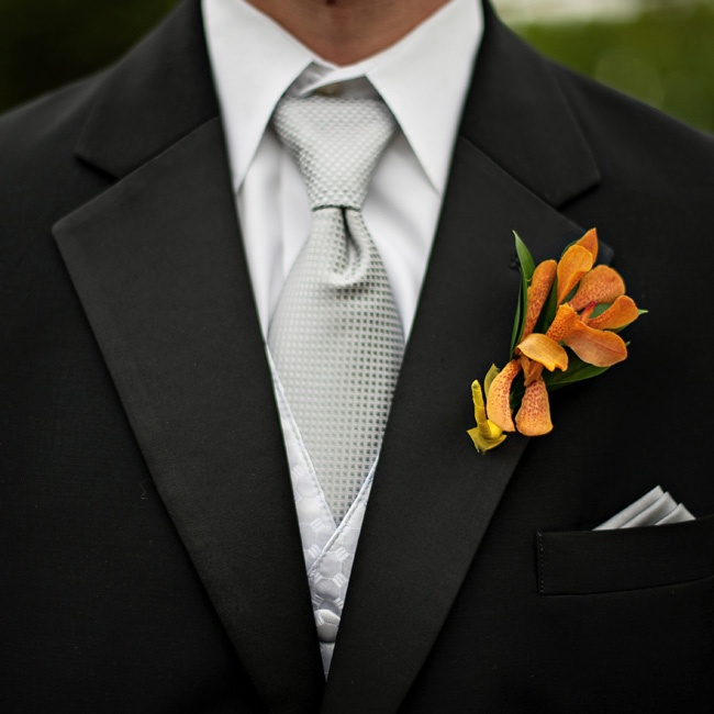 Orange orchids popped on the guys' lapels.