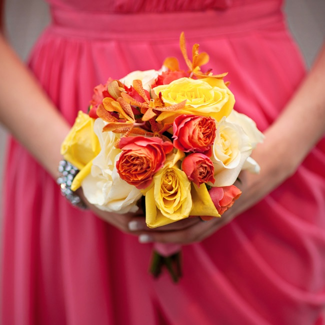 The girls carried bunches of red, yellow and ivory roses, orchids and tulips.