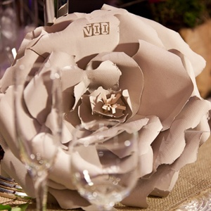 Tana used watercolor canvas paper and stamps to create the rose table numbers.