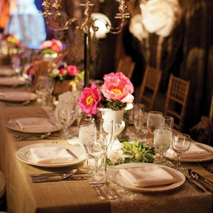 Tall silver candelabras paired with rustic burlap linens made for a casual yet elegant look.