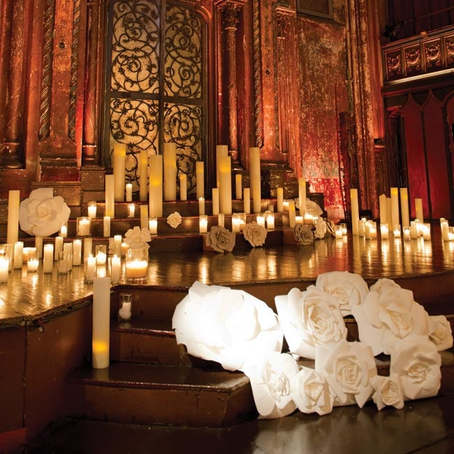Paper flowers and dozens of pillar candles created a romantic vibe during the late-morning ceremony.