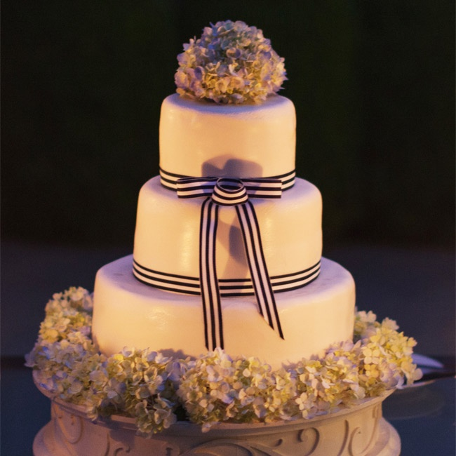 Fresh hydrangeas and blue-and-white ribbons topped the white-fondant cake.
