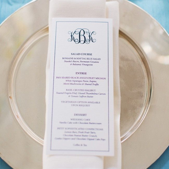 Silver chargers were topped with rectangular menu cards that featured the couple's custom monogram at the top.