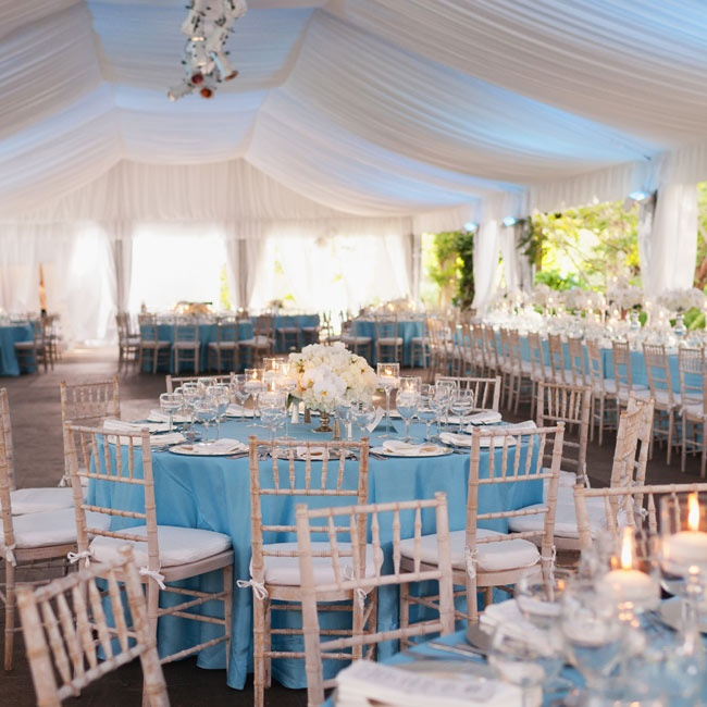 Light-blue linens, airy white draping and pale wooden chiavari chairs gave the tent a natural, elegant look