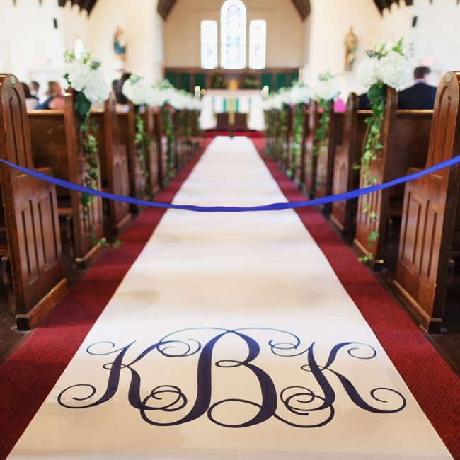 A custom runner with the couple's monogram ran the length of the aisle.