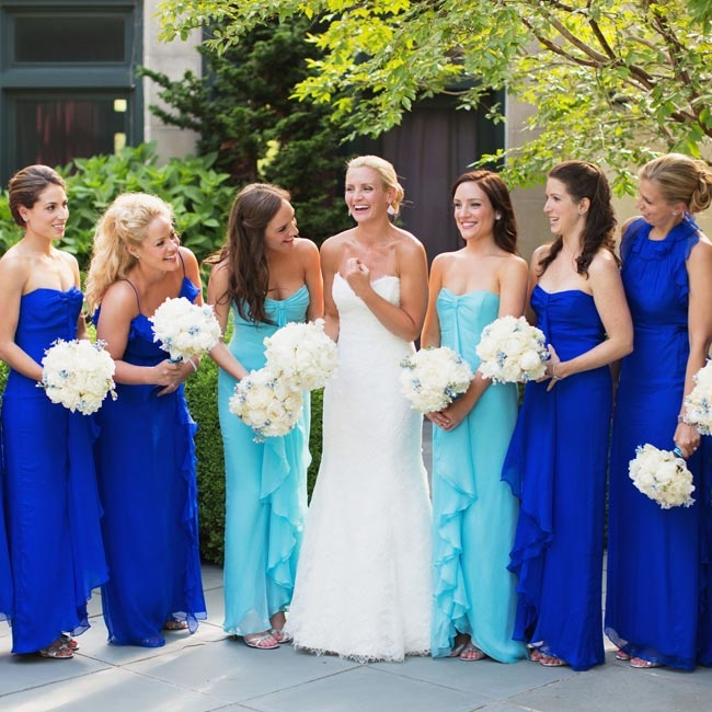 The bridesmaids wore blue chiffon dresses in different silhouettes; the maids of honor (Kate's identical twin sisters) wore a lighter shade of blue to distinguish themselves.