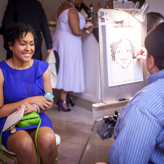 A caricature artist drew pictures of the guests during cocktail hour.