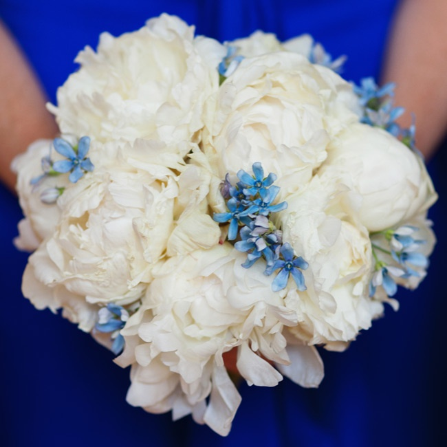 The bridesmaids carried white peony bouquets with little blue flowers tucked in.