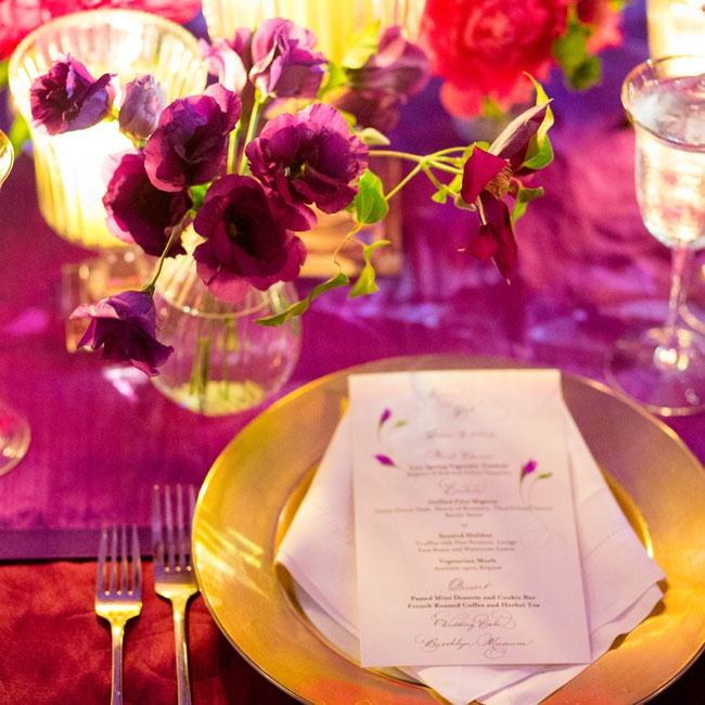 Brushed-gold chargers were topped with scripted menus decorated with pink flowers.