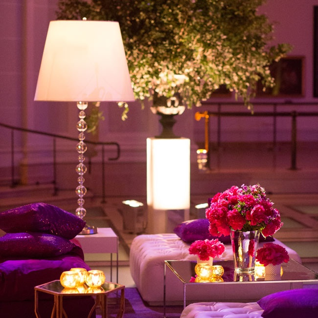 The couple's lounge setup included white-leather furniture and plush purple throw pillows.