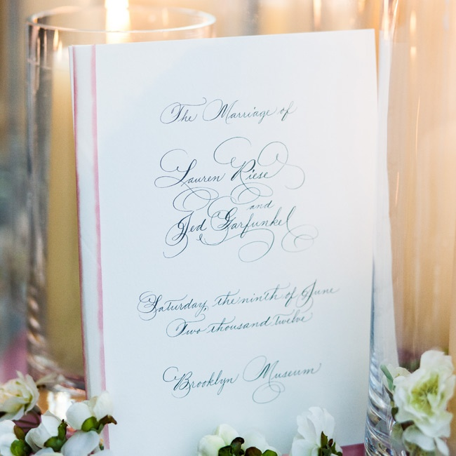 The classic programs featured a black script font and were tied together with a pink silk ribbon.