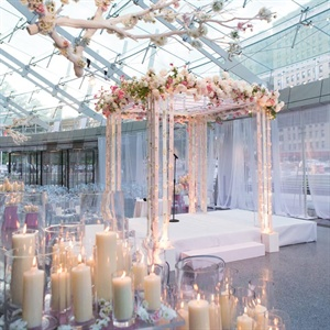 The modern Lucite huppah was decorated with peonies and blush and ivory ribbons.