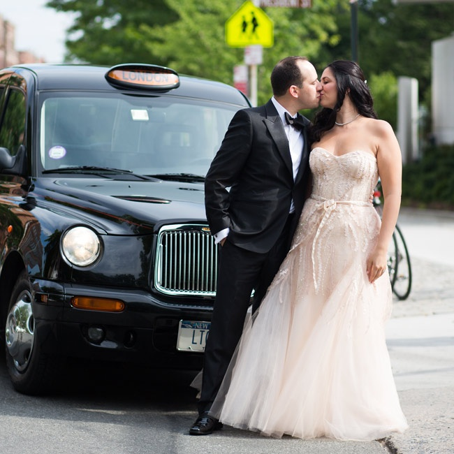 Lauren surprised Jed with a black London taxi (he's a big fan of England) for some fun wedding photos nearby.