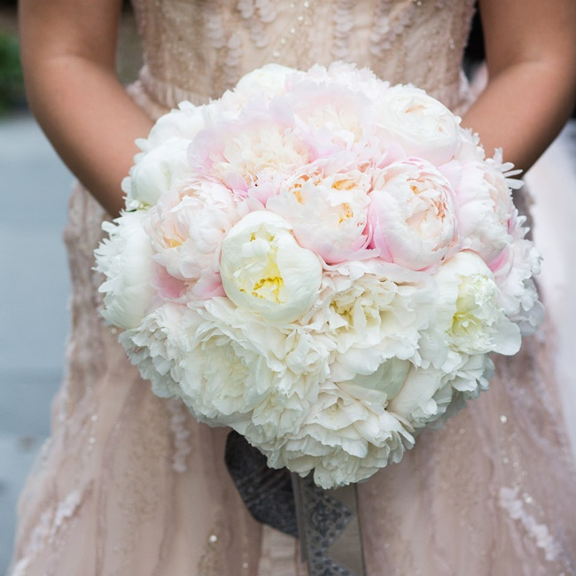 Lauren carried a lush round bouquet of ivory- and blush-colored peonies.