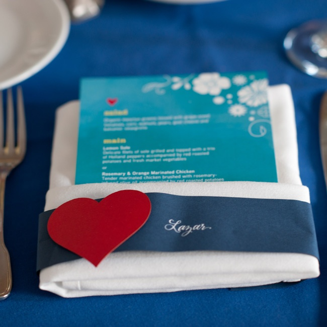The heart motif from the invitations showed up at guests' place settings.