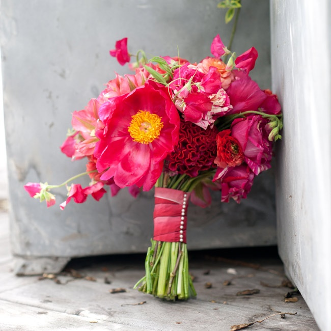 Sarah carried a vibrant pink-and-red bouquet of peonies, cockscomb, roses and sweet peas (a cute nod to her maiden name).